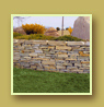 Retaining wall with Juniper plantings and mountain view